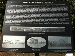 Sign telling about Greeley's business district